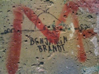 "The infamous ""Kilroy was here"" graffiti on a piece of the Berlin Wall located in the Newseum in Washington, D.C., USA."