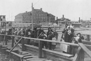 Immigrants entering Ellis Island in 1902.