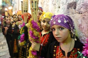 Children perform in Jerusalem's Old City during celebrations to mark the breaking of the fast on the seventh day of the holy month of Ramadan, on July 26, 2012. AFP PHOTO / AHMAD GHARABLI        (Photo credit should read AHMAD GHARABLI/AFP/GettyImages)