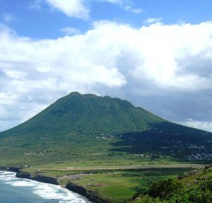 The dormant Quill Volcano in St. Eustatius. The end of the runway at  F.D. Roosevelt Airport can even be seen at the base of the volcano.
