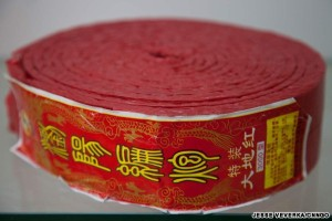 A roll of standard firecrackers, manufactured in China and sold worldwide.