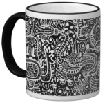 "The ""Fira"" mug in white on black."