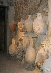 Wine in Rome was stored in amphorae like the ones in this image.