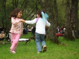 Two children dance while celebrating at Sizdah Bedar.