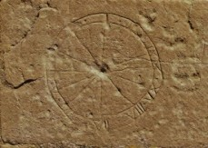 Sundial etched onto a church wall. Credit: Lincolnshire Medieval Graffiti Project