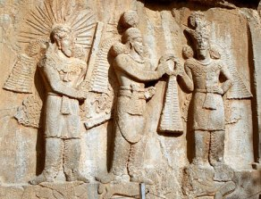 Investiture of Sassanid emperor Shapur II (center) with Mithra (left) and Ahura Mazda, 'the good twin' (right) at Taq-e Bostan, Iran. Source: Wikipedia