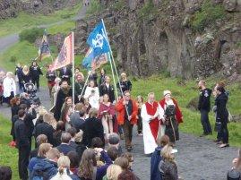Hilmar Örn Hilmarsson and other members of Ásatrúarfélagið walk to a blót at Þingvellir in the summer of 2009.