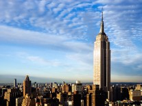 Empire State Building, New York City. It is a symbol of wealth, achievement and even welcome to visitors.