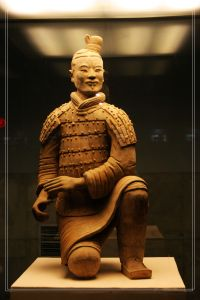 A kneeling crossbowman from the Terracotta Army assembled for the tomb complex of Qin Shi Huang (r. 221–210 BC)