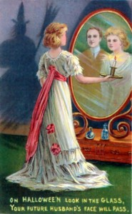 In this 1904 Halloween greeting card, divination is depicted: the young woman looking into a mirror in a darkened room hopes to catch a glimpse of her future husband.